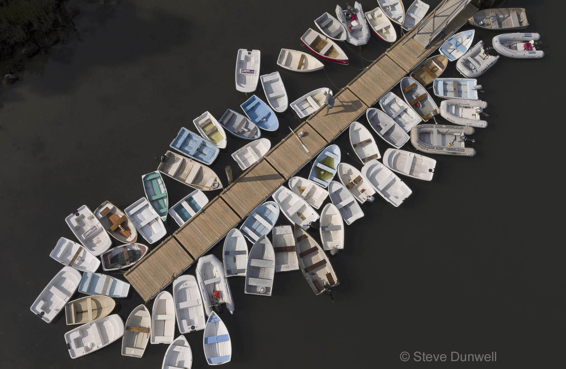 wharf with dinghies, harbor at West Falmouth, MA Cape Cod